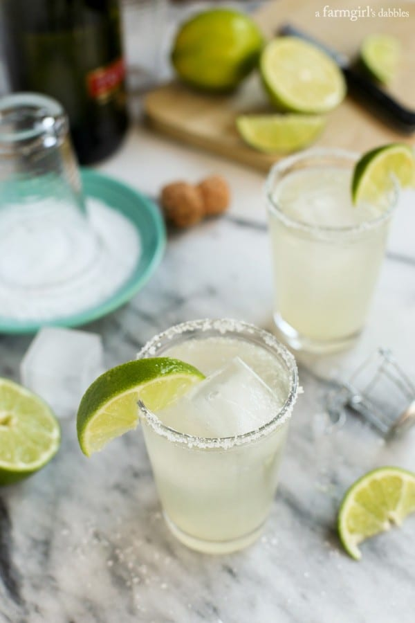 Prosecco-margaritas-big-batch-cocktail. A party isn't a party without some crowd pleasing cocktails. Save your sanity at your next party by having a few of these make-ahead big batch cocktails mixed and ready to serve. Click here to check out these delicious big batch cocktail recipes now.