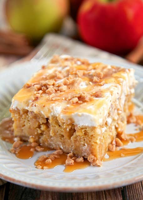 Caramel Apple Poke Cake - These Fall recipes are perfect for the holidays and for any time you want to bring the delicious smells of apple, cinnamon, and pumpkin into your home. You're guaranteed to find a fall flavor you love with these 18 delicious fall dessert recipes.