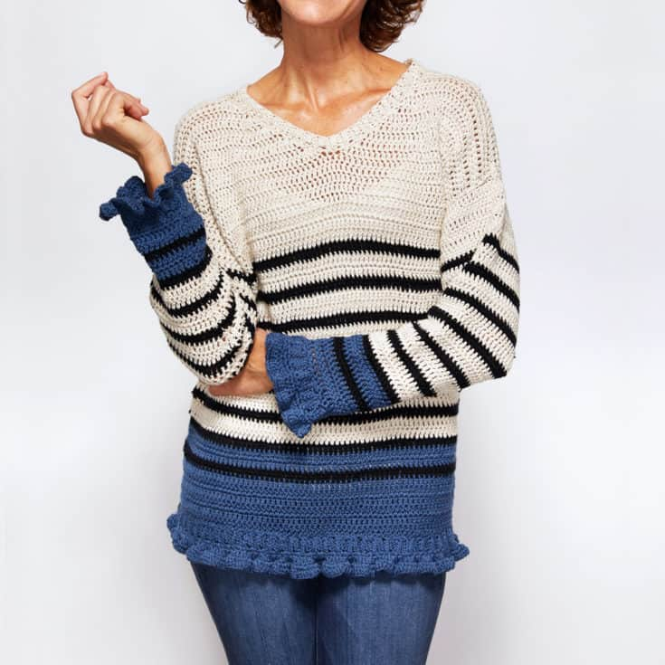 If you're looking for an adorable classic sweater, look no further than the Breton Ruffle Cuff Sweater! #crochetpattern #crochettop #crochetsweater #crochetlove #crochetaddict