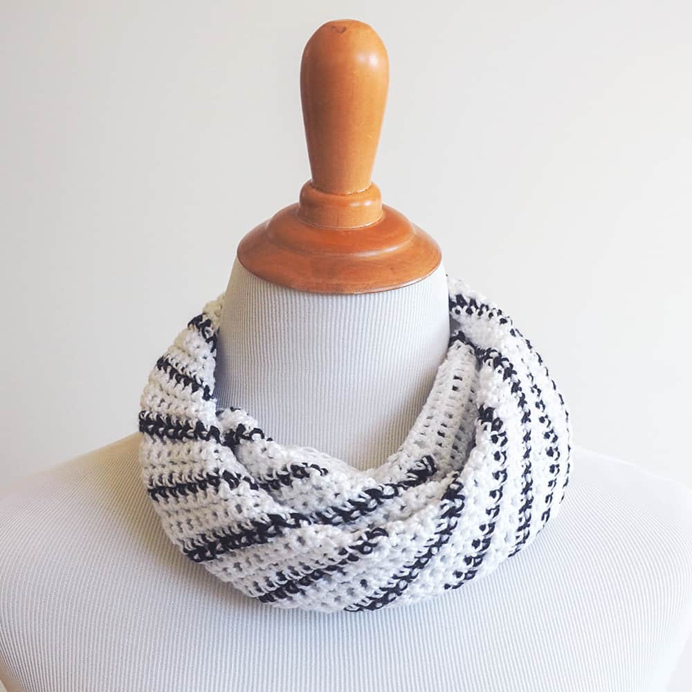 The Striped Neck Scarf is so chic and will have you daydreaming of French countrysides. #crochetscarf #crochetpattern #crochetlove #crochetaddict
