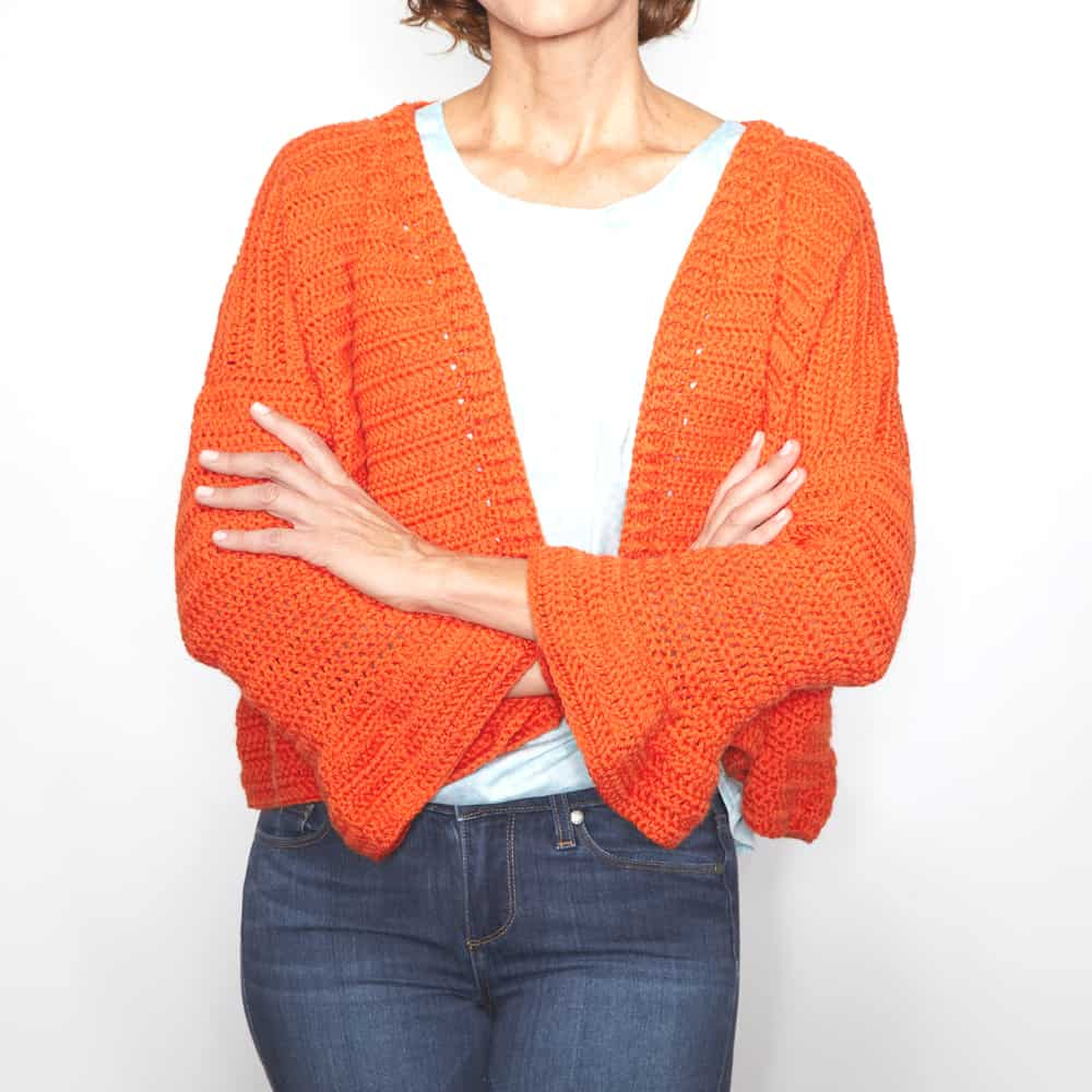The Cute Flare Sleeve Cardigan is relaxed, with a boxy fit, and cute ¾ length flare sleeves that you can throw over a tank or tee for a little extra warmth. #crochetcardigan #crochetpattern #crochetlove #crochetaddict