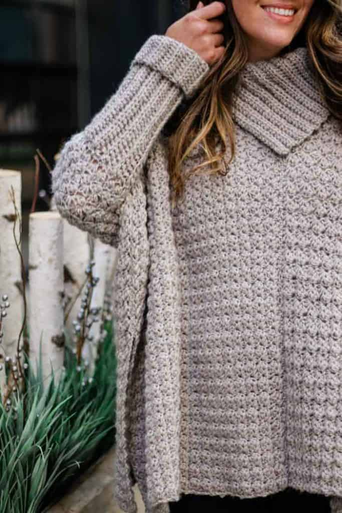 Simple Poncho with Sleeves - If you want to learn how to make a poncho, this list of 18 free crochet poncho patterns will help you. Pick your favorite from this bunch and start creating. #CrochetPonchoPatterns #FreeCrochetPatterns #CrochetAddict