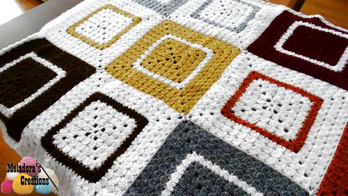 Cluster Granny Square Afghan - Crochet afghans are colorful and exciting and full of life. There's so much room for creativity in these crochet blanket patterns. #CrochetAfghans #CrochetPatterns #CrochetBlankets