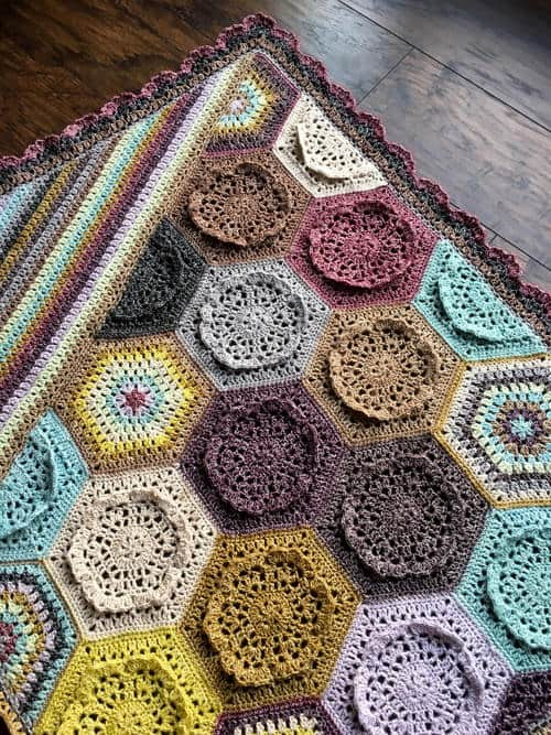 Dutch Rose Blanket - Crochet afghans are colorful and exciting and full of life. There's so much room for creativity in these crochet blanket patterns. #CrochetAfghans #CrochetPatterns #CrochetBlankets