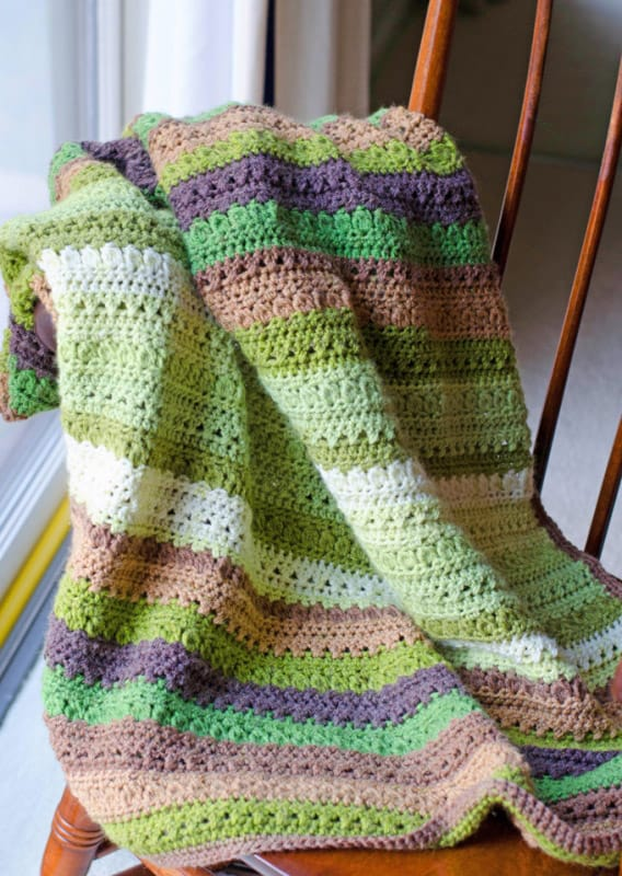 Fields and Furrows Afghan - Crochet afghans are colorful and exciting and full of life. There's so much room for creativity in these crochet blanket patterns. #CrochetAfghans #CrochetPatterns #CrochetBlankets