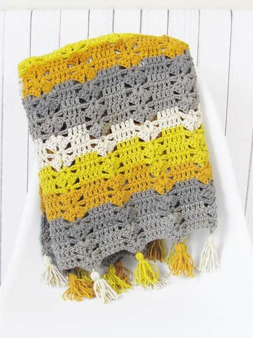 Fireplace Afghan - Crochet afghans are colorful and exciting and full of life. There's so much room for creativity in these crochet blanket patterns. #CrochetAfghans #CrochetPatterns #CrochetBlankets