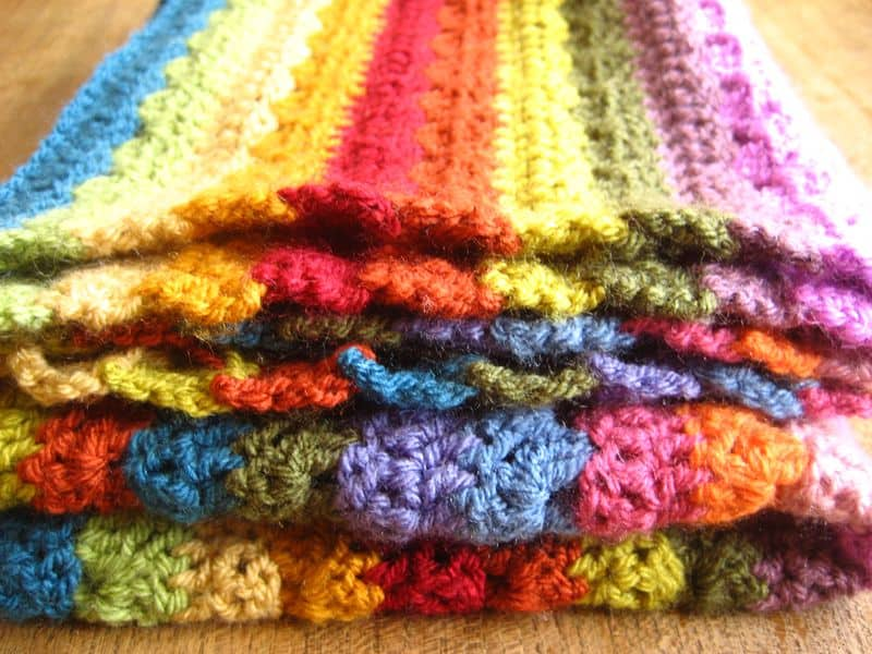 Relaxing Rainbow Blanket - Crochet afghans are colorful and exciting and full of life. There's so much room for creativity in these crochet blanket patterns. #CrochetAfghans #CrochetPatterns #CrochetBlankets