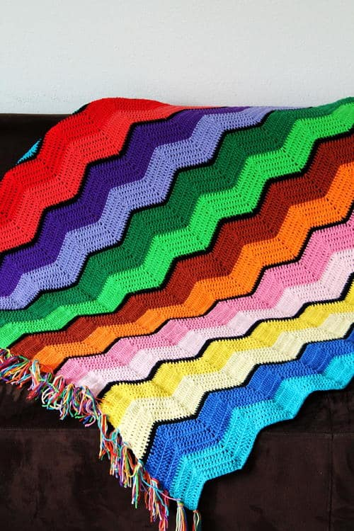 Retro Ripple Afghan - Crochet afghans are colorful and exciting and full of life. There's so much room for creativity in these crochet blanket patterns. #CrochetAfghans #CrochetPatterns #CrochetBlankets