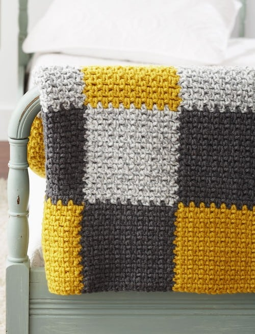 Stellar Patchwork Blanket - Crochet afghans are colorful and exciting and full of life. There's so much room for creativity in these crochet blanket patterns. #CrochetAfghans #CrochetPatterns #CrochetBlankets