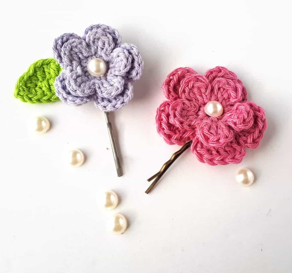 Spring Flower Hair Clips - Learn how to crochet a flower and bring the magic of nature into your life with these crochet patterns.  Each one is unique and colorful. #CrochetFlowerPatterns #CrochetPatterns #FreeCrochetPatterns