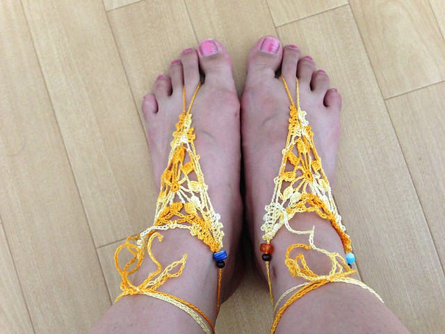 Sunflower Barefoot Sandals - These crochet sandals and barefoot sandals are the perfect summer crochet projects. These crochet patterns take just a little bit of yarn. #CrochetSandals #CrochetPatterns #CrochetSandalPatterns