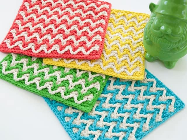 Bright Chevron Dishcloth - These crochet dishcloth patterns are all free and are so different from each other. Test your creativity with one of these brilliant dishcloth patterns. #CrochetDishclothPatterns #CrochetPatterns #DishclothPatterns