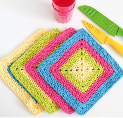 Colorful Solid Granny Square Dishcloth - These crochet dishcloth patterns are all free and are so different from each other. Test your creativity with one of these brilliant dishcloth patterns. #CrochetDishclothPatterns #CrochetPatterns #DishclothPatterns