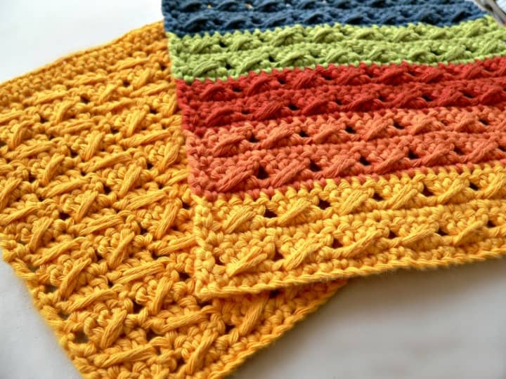 Crochet Cable Stitch Dishcloth - These crochet dishcloth patterns are all free and are so different from each other. Test your creativity with one of these brilliant dishcloth patterns. #CrochetDishclothPatterns #CrochetPatterns #DishclothPatterns