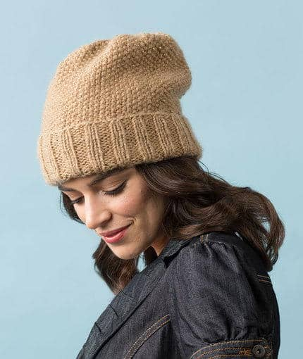 Camel Seed Stitch Slouchy Hat - These 23 easy knitting patterns for hats are a perfect starting place for beginners, and they're fun to do for even seasoned knitters. #knittingpatterns #knithatpatterns