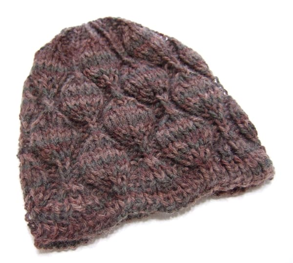 Embossed Leaves Hat - These 23 easy knitting patterns for hats are a perfect starting place for beginners, and they're fun to do for even seasoned knitters. #knittingpatterns #knithatpatterns