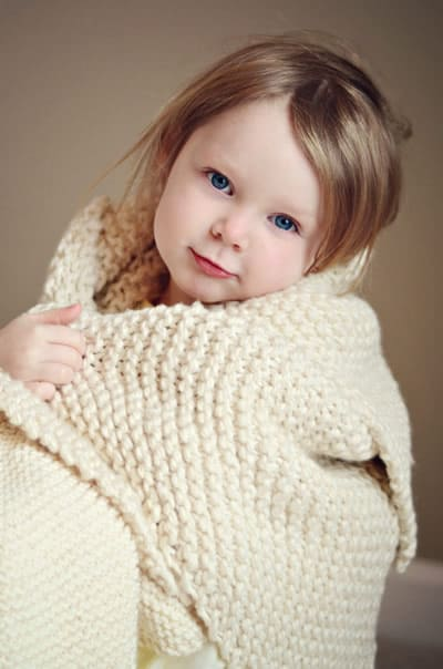 Garter Stitch Blanket - These knitting patterns for baby blankets are easy and adorable you might find yourself making more than just one! #knittingpatterns #babyblanketknittingpatterns #babyblankets