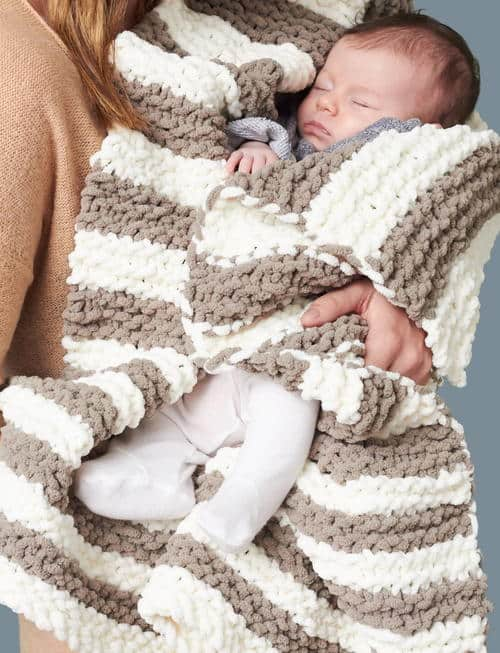In A Wink Baby Blanket - These knitting patterns for baby blankets are easy and adorable you might find yourself making more than just one! #knittingpatterns #babyblanketknittingpatterns #babyblankets