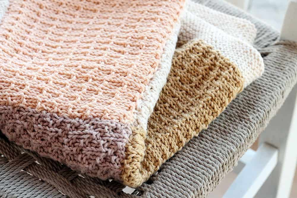 Knitted Baby Blanket - These knitting patterns for baby blankets are easy and adorable you might find yourself making more than just one! #knittingpatterns #babyblanketknittingpatterns #babyblankets