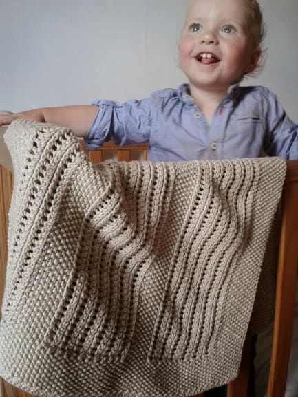 Moss and Lace Rib Baby Blanket - These knitting patterns for baby blankets are easy and adorable you might find yourself making more than just one! #knittingpatterns #babyblanketknittingpatterns #babyblankets