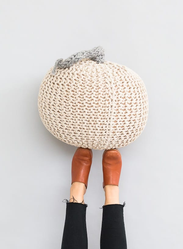 Giant Knit Pumpkin - We've got 16 quick and easy Thanksgiving knitting patterns for anything from hats, to centerpiece decorations. #knittingpatterns #thanksgivingknittingpatterns #freeknittingpatterns