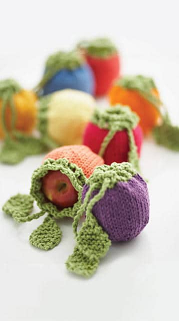 Horn of Plenty Fruit Cozies - We've got 16 quick and easy Thanksgiving knitting patterns for anything from hats, to centerpiece decorations. #knittingpatterns #thanksgivingknittingpatterns #freeknittingpatterns