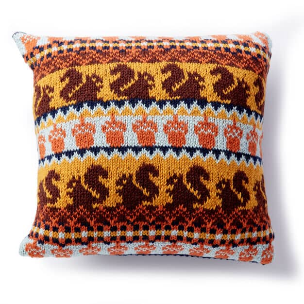 Patons Autumn Harvest Knit Pillow - We've got 16 quick and easy Thanksgiving knitting patterns for anything from hats, to centerpiece decorations. #knittingpatterns #thanksgivingknittingpatterns #freeknittingpatterns