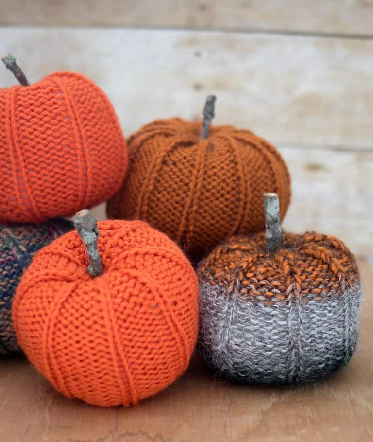 Scrap Yarn Pumpkin - We've got 16 quick and easy Thanksgiving knitting patterns for anything from hats, to centerpiece decorations. #knittingpatterns #thanksgivingknittingpatterns #freeknittingpatterns