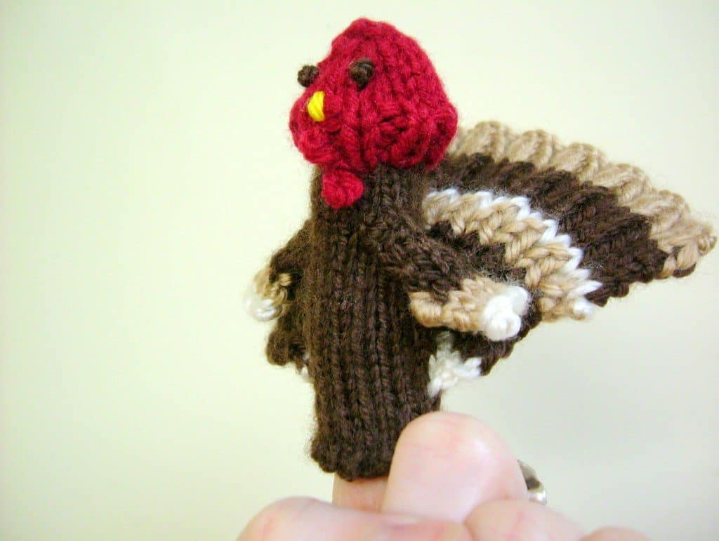 Turkey Finger Puppet - We've got 16 quick and easy Thanksgiving knitting patterns for anything from hats, to centerpiece decorations. #knittingpatterns #thanksgivingknittingpatterns #freeknittingpatterns