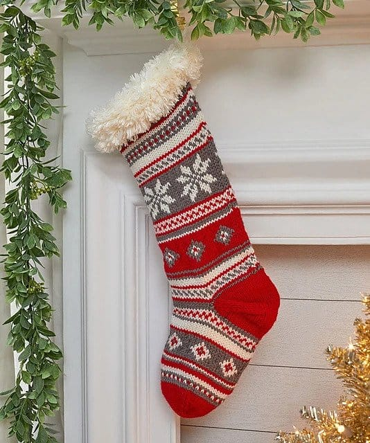 Festive Fair Isle Knit Stocking - Explore these 11 free Fair Isle holiday knit patterns that will turn your knit projects from ordinary to holiday ready! #fairisleknit #holidayknits