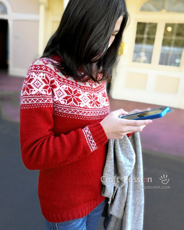 Poinsettia Fair Isle Pullover - Explore these 11 free Fair Isle holiday knit patterns that will turn your knit projects from ordinary to holiday ready! #fairisleknit #holidayknits
