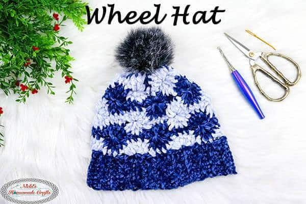 Wheel Hat - These 26 crochet winter hat patterns are perfect to create a winter hat accessory that you love and can rely on. #crochetwinterhat #crochetpatterns #crochethatpatterns