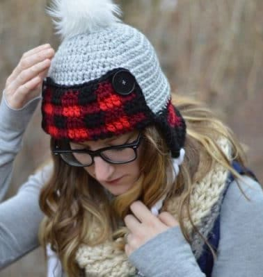 Women's Crochet Plaid Trapper Hat - These 26 crochet winter hat patterns are perfect to create a winter hat accessory that you love and can rely on. #crochetwinterhat #crochetpatterns #crochethatpatterns