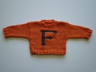 Baby Weasley Sweater - Keep yourself warm and comfy this season by knitting one of these knitted sweater patterns. You can choose from the basic pullover to a more daring design. #knittedsweaterpatterns #knittingpatterns #knitsweaterpatterns