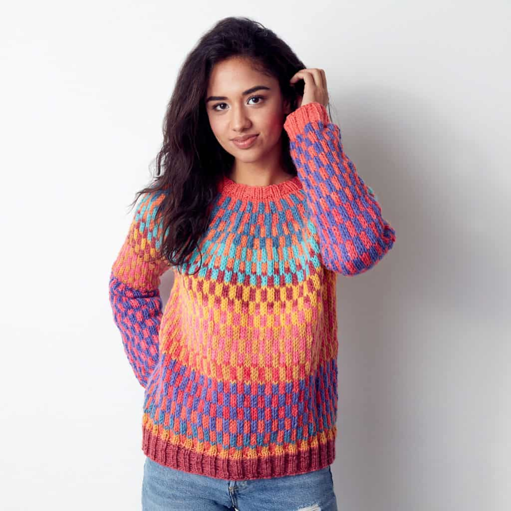 Bernat On Repeat Knit Pullover - Keep yourself warm and comfy this season by knitting one of these knitted sweater patterns. You can choose from the basic pullover to a more daring design. #knittedsweaterpatterns #knittingpatterns #knitsweaterpatterns