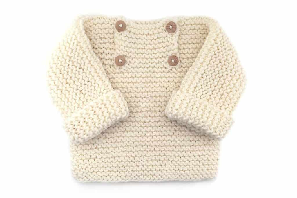 Garter Stitch Baby Sweater - Keep yourself warm and comfy this season by knitting one of these knitted sweater patterns. You can choose from the basic pullover to a more daring design. #knittedsweaterpatterns #knittingpatterns #knitsweaterpatterns