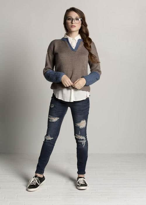 Henley Knit Sweater - Keep yourself warm and comfy this season by knitting one of these knitted sweater patterns. You can choose from the basic pullover to a more daring design. #knittedsweaterpatterns #knittingpatterns #knitsweaterpatterns