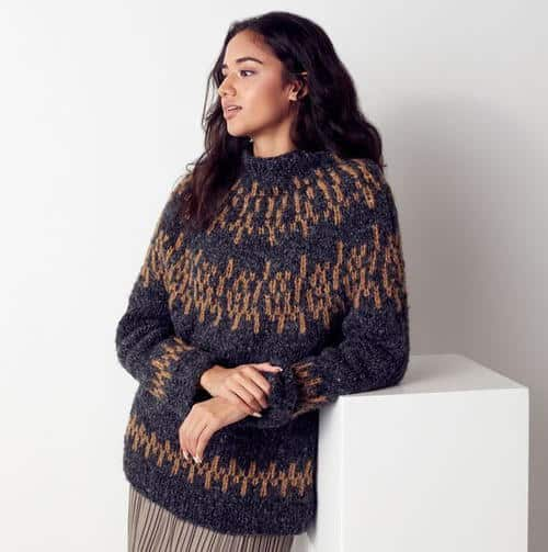 Nordic-Inspired Knit Sweater - Keep yourself warm and comfy this season by knitting one of these knitted sweater patterns. You can choose from the basic pullover to a more daring design. #knittedsweaterpatterns #knittingpatterns #knitsweaterpatterns