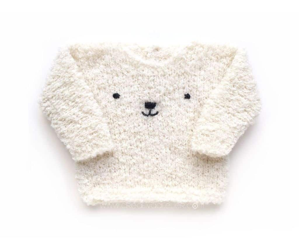 Teddy Bear Sweater - Keep yourself warm and comfy this season by knitting one of these knitted sweater patterns. You can choose from the basic pullover to a more daring design. #knittedsweaterpatterns #knittingpatterns #knitsweaterpatterns