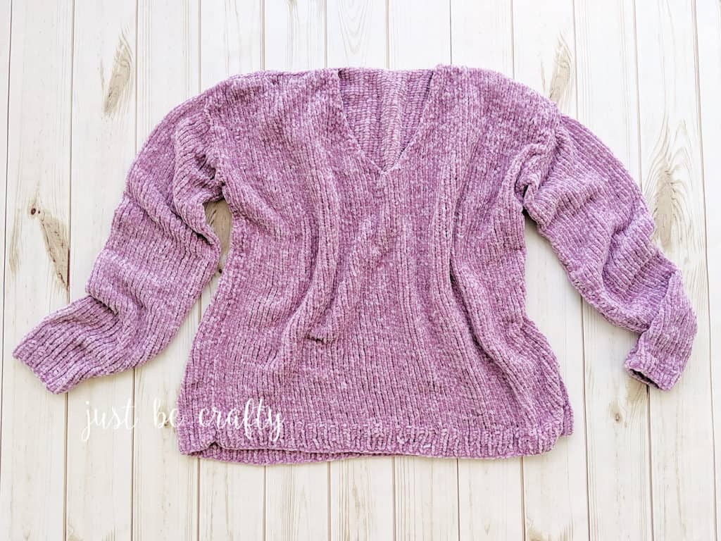 Velvet Slouchy V-Neck Knit Sweater - Keep yourself warm and comfy this season by knitting one of these knitted sweater patterns. You can choose from the basic pullover to a more daring design. #knittedsweaterpatterns #knittingpatterns #knitsweaterpatterns